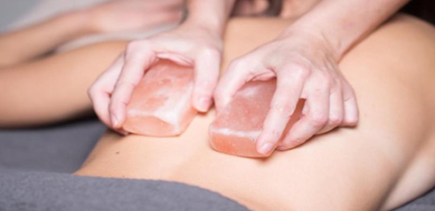 A lady is having a body and scrub treatment in London's cloud twelve luxury spa.