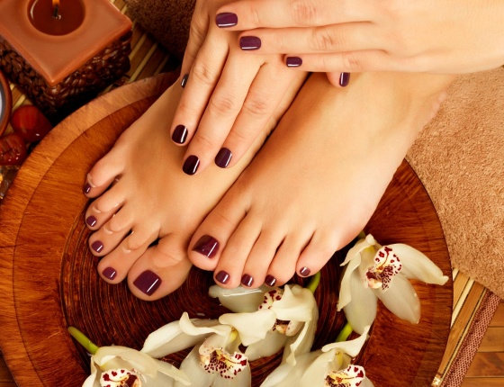 A woman is having a manicure and pedicure in luxury salon