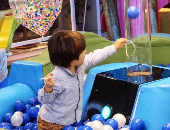 A child is playing at Cloud Twelve's play zone